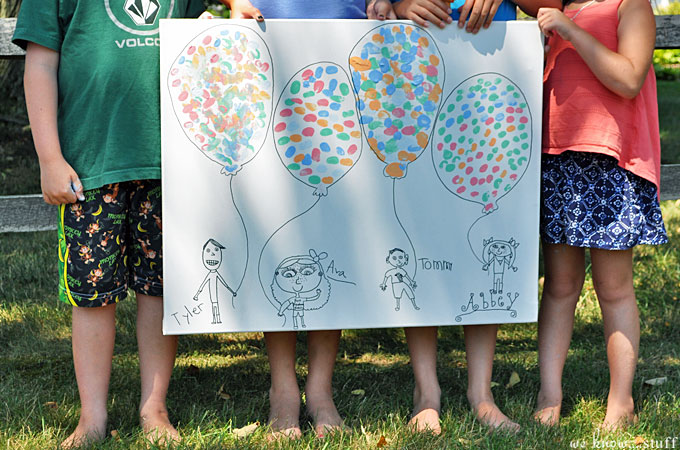 This DIY canvas wall art project is a simple, cheap way to add original artwork to your home. Caricatures of the kids and thumbprint balloons keep it sweet.