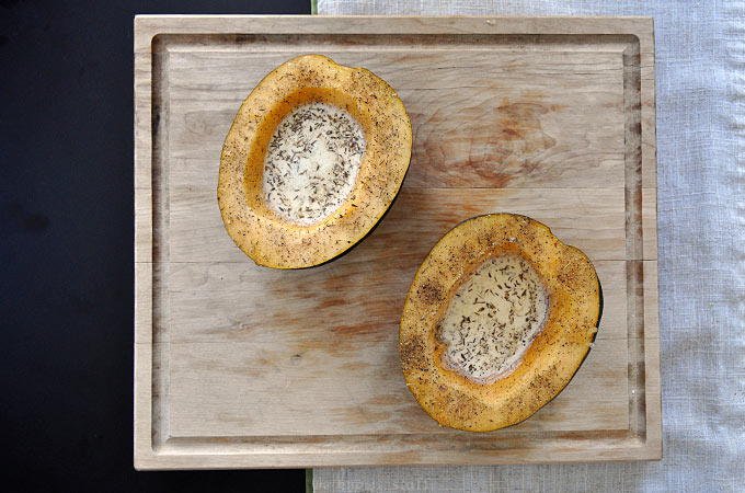 Need an Easy Baked Acorn Squash Recipe? Look no further. This creamy, parmesan version is kid-friendly and a cinch to put together for busy weeknight meals!
