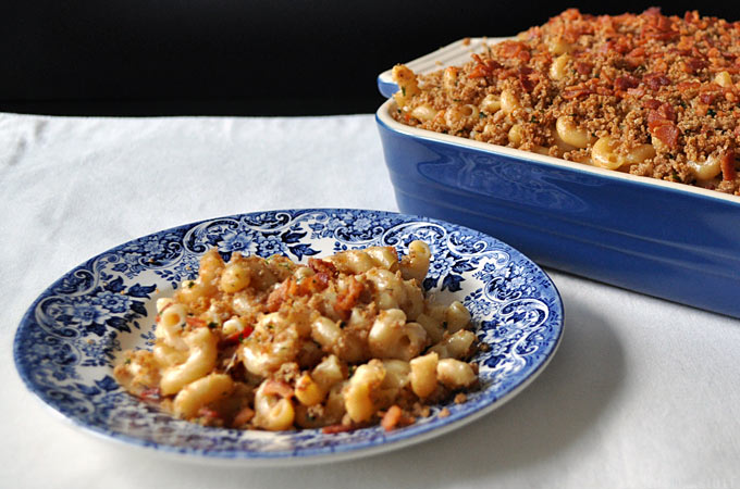 his homemade Baked Mac And Cheese With Crunchy Topping recipe gets it's crunch from crispy bacon and panko, and it's spicy kick from tabasco sauce!