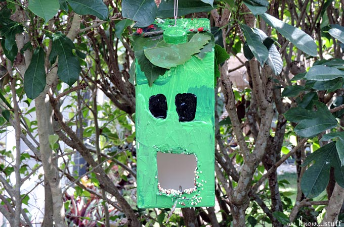 This Minecraft Creeper Milk Container Bird Feeder is an awesome way to get kids involved with nature. It's also a great recycling craft for sunny weekend afternoons!