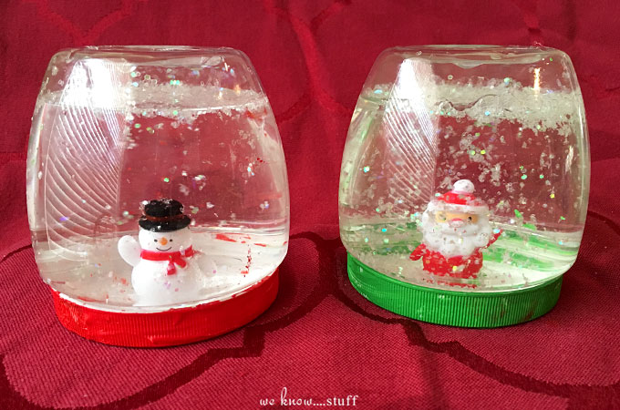 Our super simple Snow Globes For Kids are a fun way to spend time with your kiddos this holiday season. Plastic jars keep them from breaking in tiny hands.