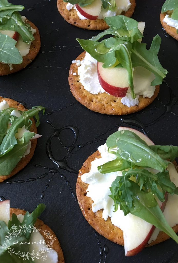 This Goat Cheese Arugula Apple Garnish is a super simple way to elevate a cracker appetizer. Full of fresh ingredients and a drizzle of honey, it's delish!