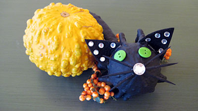 Do you need an idea for a fun DIY Halloween Kids Craft? Our super cute Glitzy Gourd Kitties are so much fun to make and our children love them!