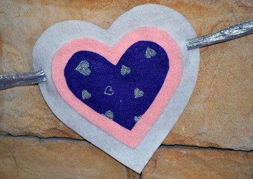 How To Make A Heart Banner: This kid-friendly Valentine's Day project is incredibly easy and adaptable for all ages. Simply grab your kids, settle in, and enjoy.