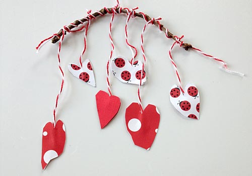 Our upcycled Paper Heart Mobile is a delightful kids craft full of love and sweet vibes! It's just perfect for a little girl's room or to use as a homemade Valentine's Day decoration!